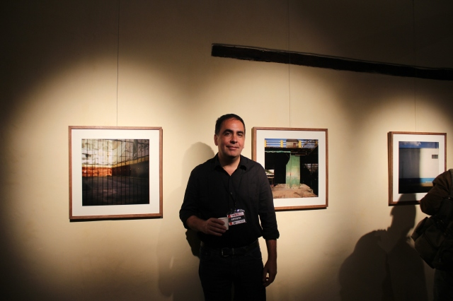 Fernando Di Sisto in front of his photographs at his opening