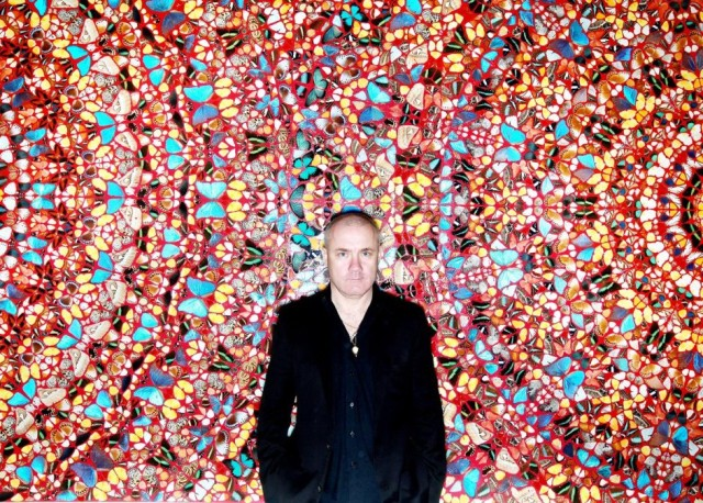 "Damien Hirst in front of his artwork ""I Am Become Death, Shatterer of Worlds"" which sold at Christies for 2,169,250"