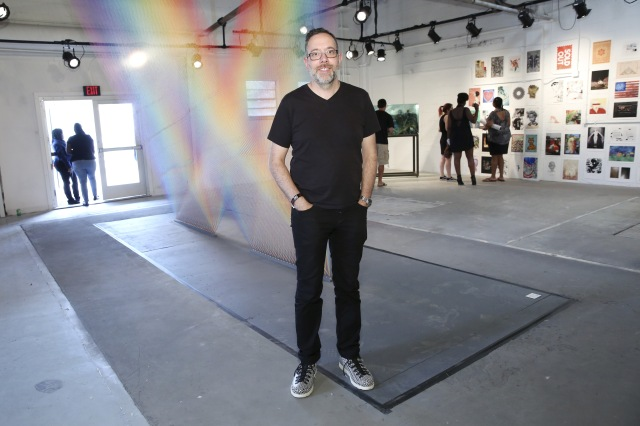 MIAMI, FL - DECEMBER 03: Artist Gabriel Dawe poses for a portrait in front of his artwork 'Plexus 32' at The Dean Collection X BACARDI No Commission Art Fair Day 1 on December 3, 2015 in Miami, Florida. (Photo by Monica Schipper/Getty Images for Bacardi)