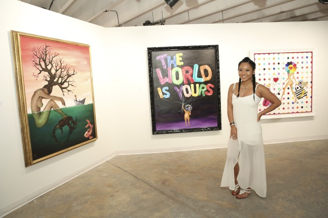 MIAMI, FL - DECEMBER 03: Artist Sue Tsai poses for a portrait in front of her artwork at The Dean Collection X BACARDI No Commission Art Fair Day 1 on December 3, 2015 in Miami, Florida. (Photo by Monica Schipper/Getty Images for Bacardi)